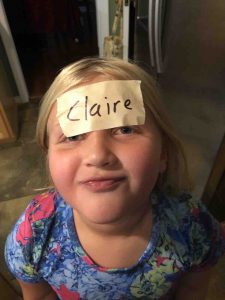"Picture of young girl with masking tape label ""Claire"""