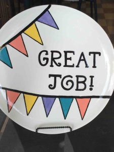 "Lapel button saying ""Great Job"""