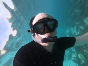 picture of author underwater with snorkel and mask