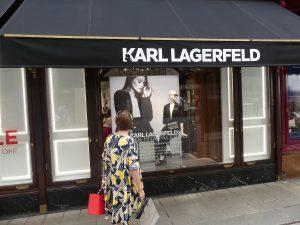 Woman looking in shop window.