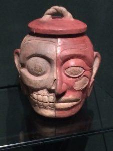 Jug with a face: half skull, half flesh