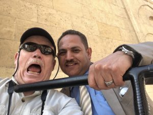 Author with Egyptian security man with nightstick at author's throat (joking around)